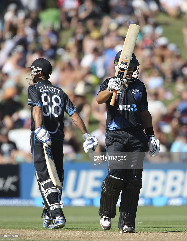 Ross Taylor of New Zealand (R) celebrates scoring 50 runs against England with teammate Grant Elliott (L) during their second one-day international cricket match at McLean Park in Napier on February 20, 2013. AFP PHOTO / John Cowpland