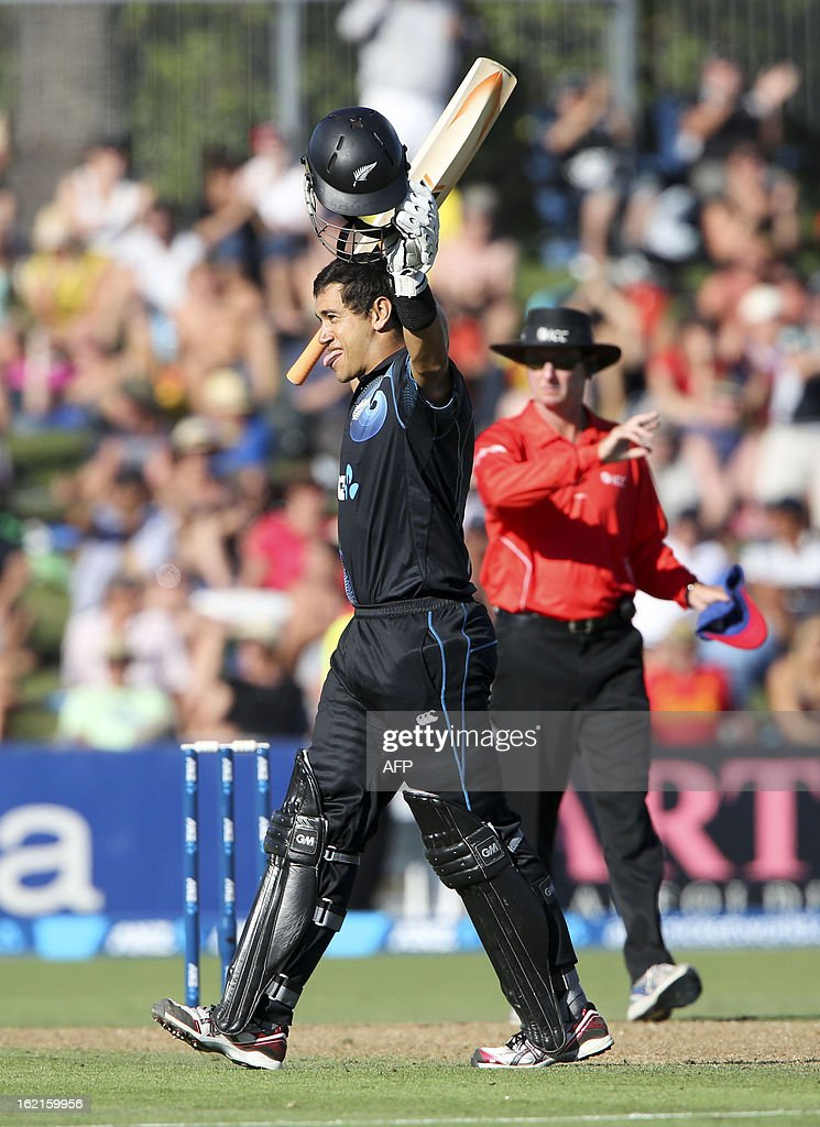 Ross Taylor of New Zealand Celebrates scoring a century against England during their second one-day international cricket match at McLean Park in Napier on February 20, 2013. AFP PHOTO / John Cowpland