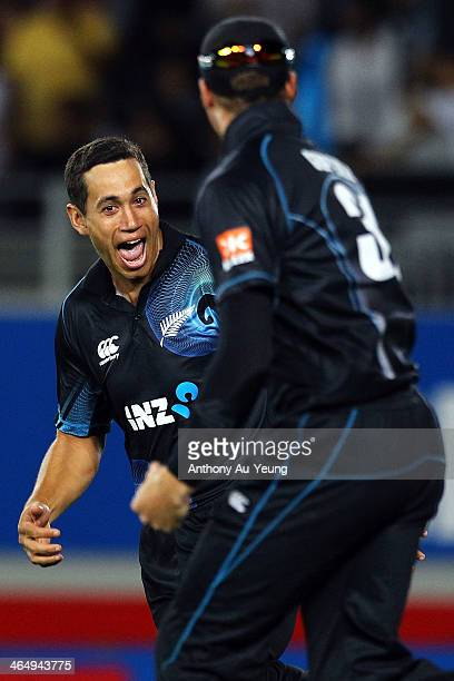 Ross Taylor of New Zealand celebrates with Martin Guptill after his catch to dismiss Ravichandran Ashwin of India during the One Day International...