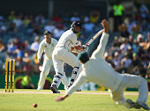 Ross Taylor of New Zealand gets his shot past David Warner of Australia during day three of the second Test match between Australia and New Zealand...