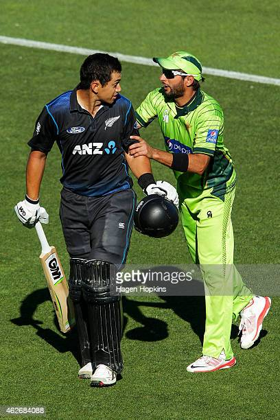 Ross Taylor of New Zealand is congratualted on his century by Shahid Afridi of Pakistan during the One Day International match between New Zealand...