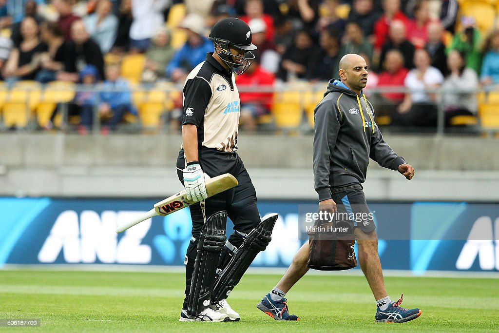 Ross Taylor of New Zealand is escorted off the pitch injured during during the Twenty20 International match between New Zealand and Pakistan at Westpac Stadium on January 22, 2016 in Wellington, New Zealand.