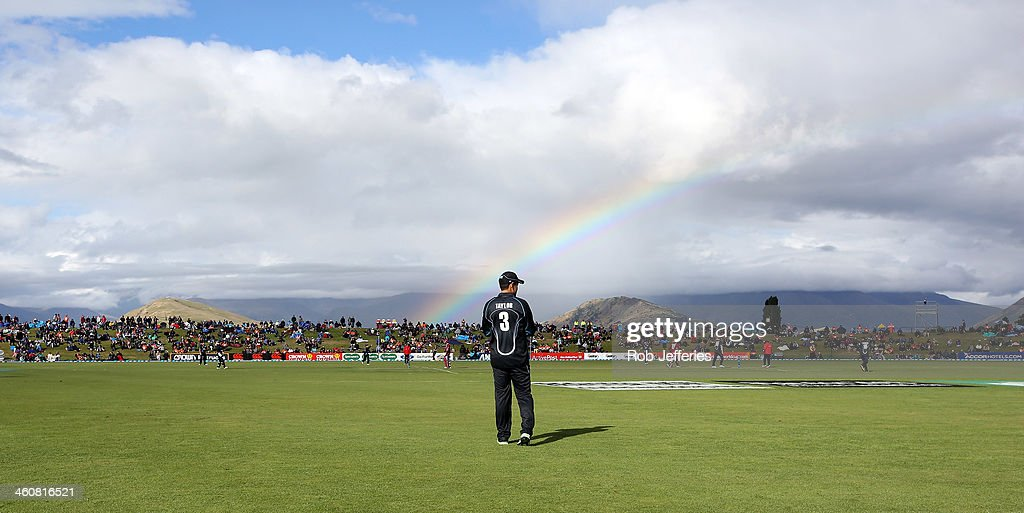Ross Taylor of New Zealand is sillouetted by a rainbow during game three of the One Day International Series between New Zealand and the West Indies...