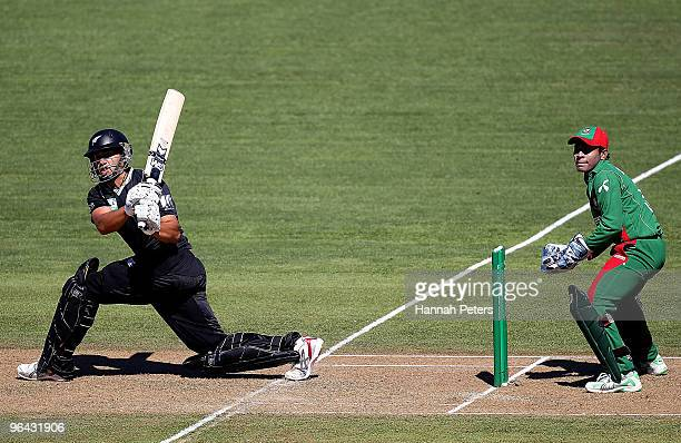 Ross Taylor of New Zealand sweeps the ball away for four runs during the first one day international match between the New Zealand Black Caps and...