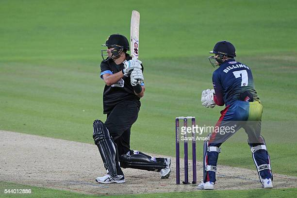 Ross Taylor of Sussex hits out as Kent wicket keeper Sam Billings looks on during the NatWest T20 Blast match between Kent and Sussex at The Spitfire...
