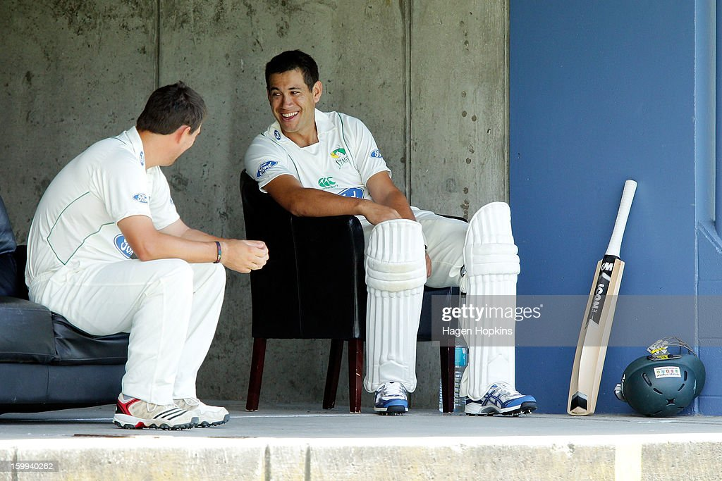 Ross Taylor (R) of the Stags enjoys a laugh with teammate Mathew Sinclair during the Plunket Shield match between the Central Stags and the Cantebury Wizards at McLean Park on January 24, 2013 in Napier, New Zealand.