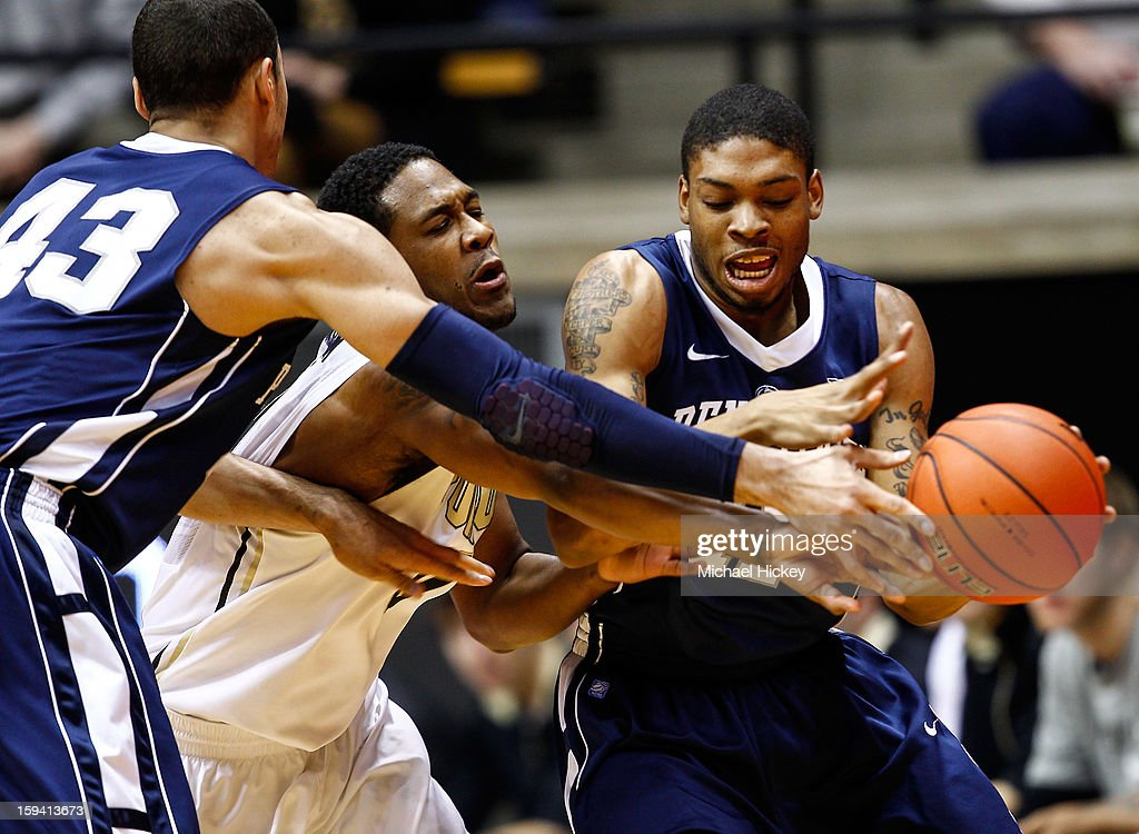Ross Travis #43 and Jermaine Marshall #11 of the Penn State Nittany Lions fight with Terone Johnson #0 of the Purdue Boilermakers for a loose ball at Mackey Arena on January 13, 2013 in West Lafayette, Indiana. Purdue defeated Penn State 60-42.