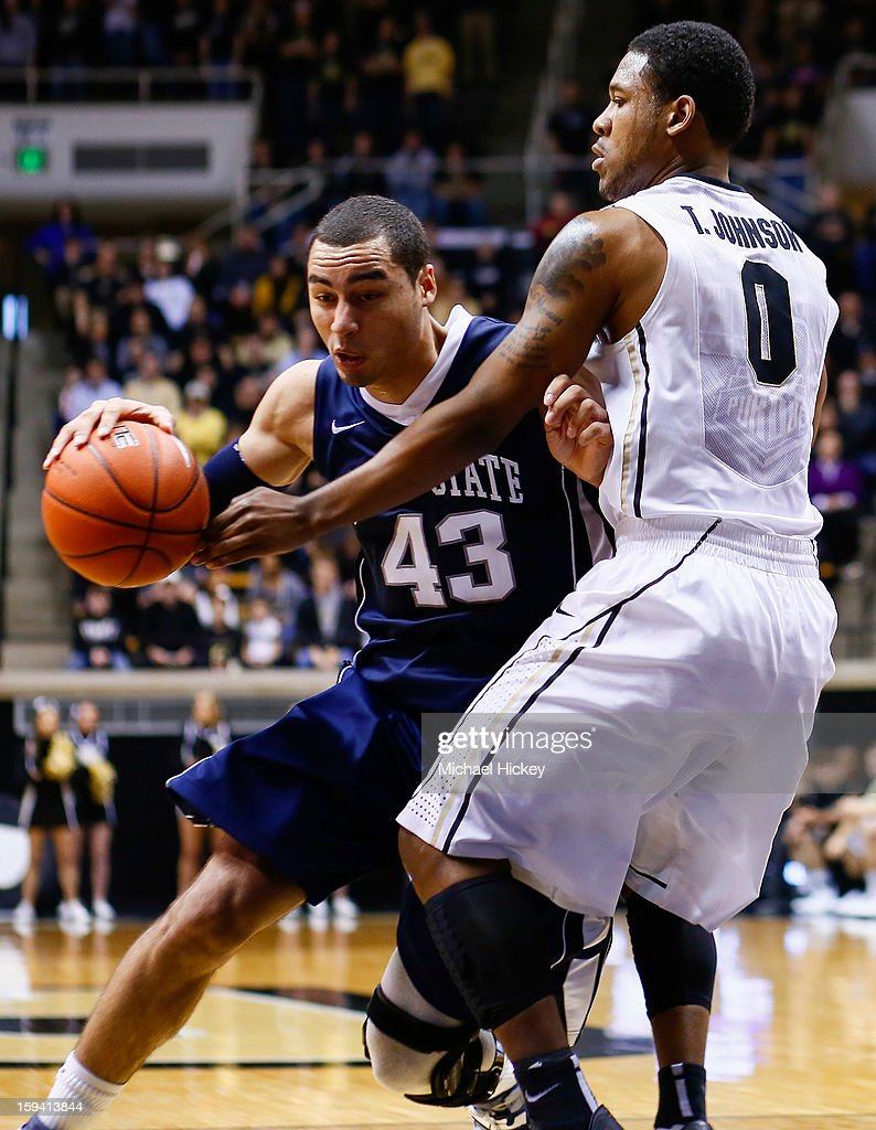 Ross Travis #43 of the Penn State Nittany Lions dribbles in the lane against Terone Johnson #0 of the Purdue Boilermakers at Mackey Arena on January 13, 2013 in West Lafayette, Indiana. Purdue defeated Penn State 60-42.