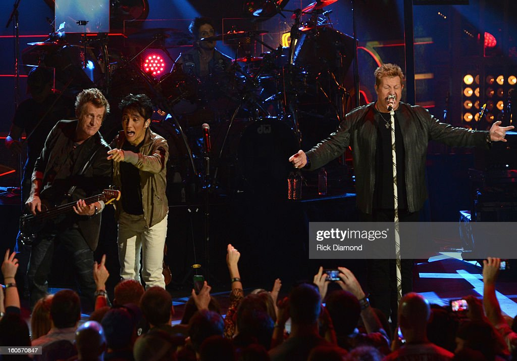 Ross Valory, Arnel Pineda, Deen Castronovo and Gary LeVox perform onstage as Journey and Rascal Flatts headline the Super Bowl XLVII CMT Crossroads Concert on February 2, 2013 in New Orleans, Louisiana.
