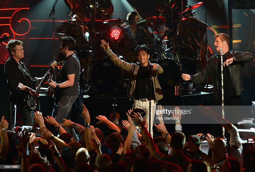 Ross Valory, Jay DeMarcus, Deen Castronovo, Arnel Pineda and Gary LeVox perform onstage as Journey and Rascal Flatts headline the Super Bowl XLVII CMT Crossroads Concert on February 2, 2013 in New Orleans, Louisiana.