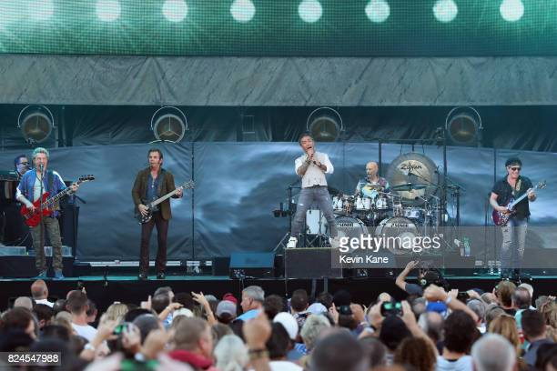 Ross Valory Jonathan Cain Arnel Pineda Steve Smith and Neal Schon of Journey perform onstage during The Classic East Day 2 at Citi Field on July 30...