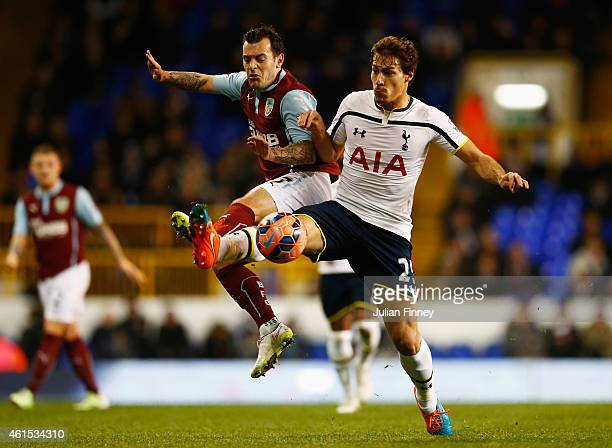 Ross Wallace of Burnley and Benjamin Stambouli of Spurs battle for the ball during the FA Cup Third Round Replay match between Tottenham Hotspur and...