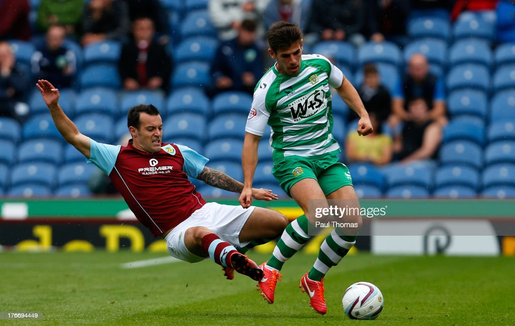 <a gi-track='captionPersonalityLinkClicked' href=/galleries/search?phrase=Ross+Wallace&family=editorial&specificpeople=800369 ng-click='$event.stopPropagation()'>Ross Wallace</a> of Burnley in action with Joe Edwards (R) of Yeovil during the Sky Bet Championship match between Burnley and Yeovil Town at Turf Moor on August 17, 2013 in Burnley, England