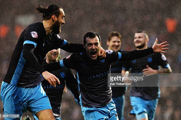 Ross Wallace of Sheffield Wednesday celebrates with team mate Atdhe Nuhiu after scoring during the Sky Bet Championship match between Fulham and...