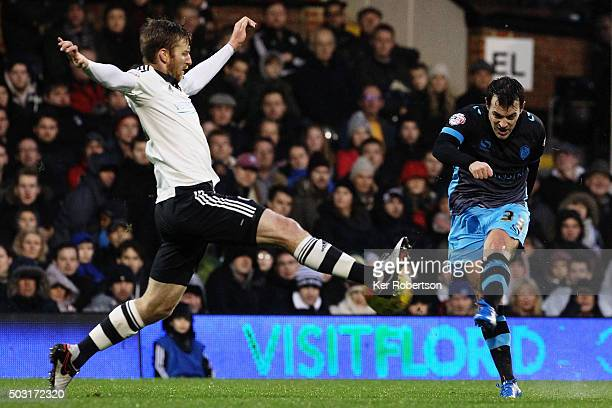 Ross Wallace of Sheffield Wednesday shoots on goal ahead of Tim Ream of Fulham during the Sky Bet Championship match between Fulham and Sheffield...