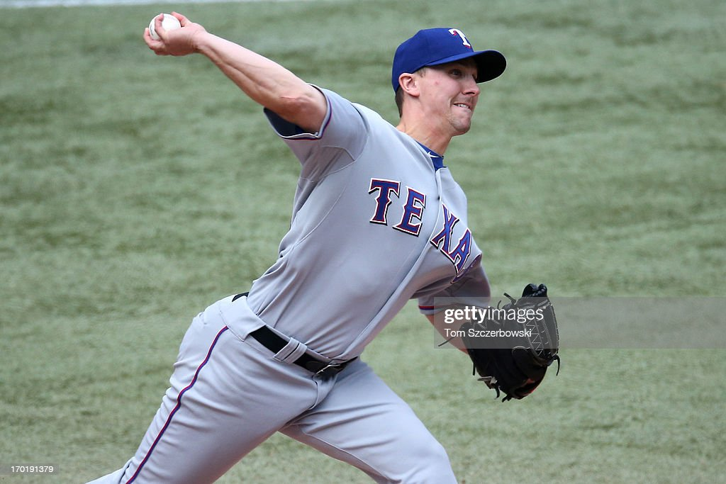Ross Wolf #55 of the Texas Rangers delivers a pitch during MLB game action against the Toronto Blue Jays on June 8, 2013 at Rogers Centre in Toronto, Ontario, Canada.