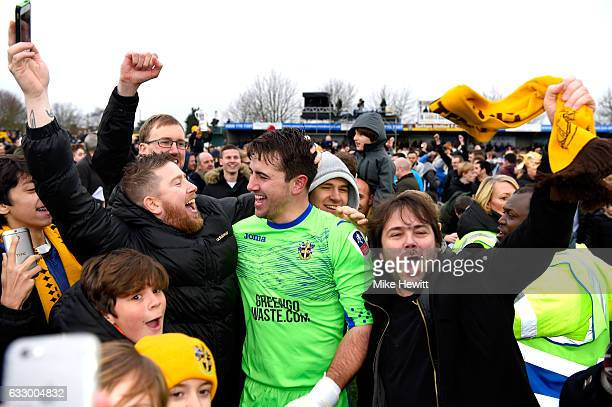 Ross Worner of Sutton United celebrates with the Sutton United fans after the Emirates FA Cup Fourth Round match between Sutton United and Leeds...