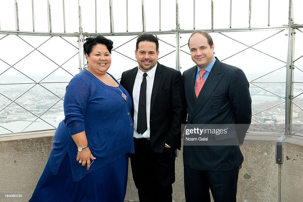Rossana Rosado, Fashion designer Narciso Rodriguez and Hernando Ruiz-Jimenez light The Empire State Building on October 11, 2013 in New York City.