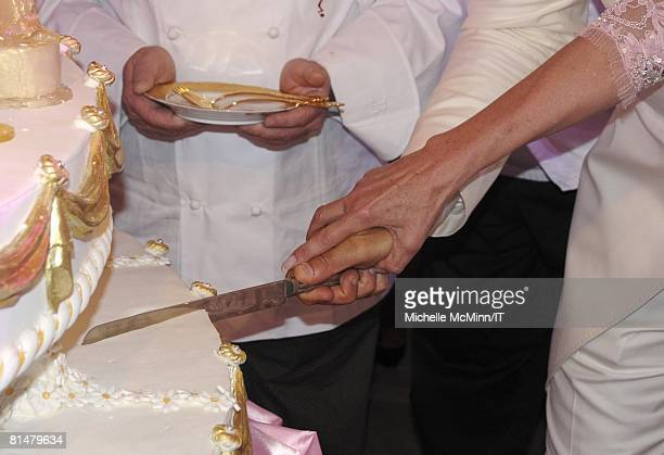Rossano Rubicondi and Ivana Trump cut the cake during their wedding reception at the MaraLago Club on April 12 2008 in Palm Beach Florida Cake...