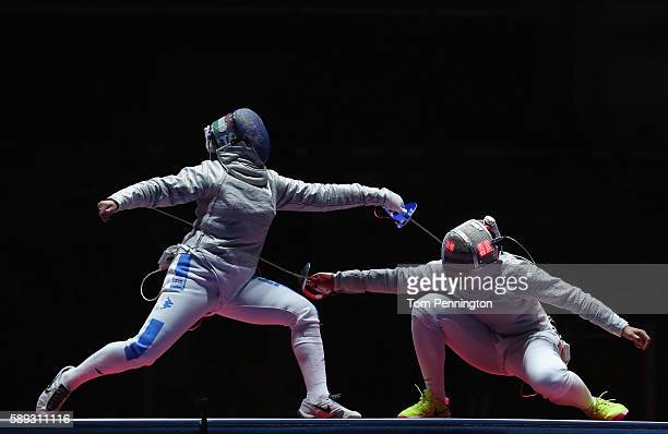 Rossella Gregorio of Italy competes against Ibtihaj Muhammad of the United States during the Women's Sabre Team bronze medal match between United...