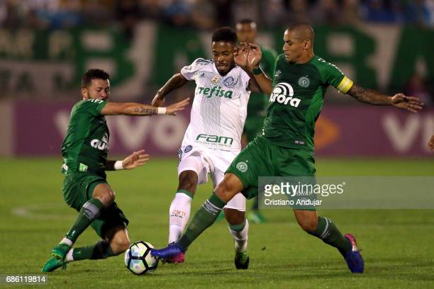 Rossi and Wellington Paulista of Chapecoense struggles for the ball with Michel Bastos of Pameiras during a match between Chapecoense Palmeiras as...