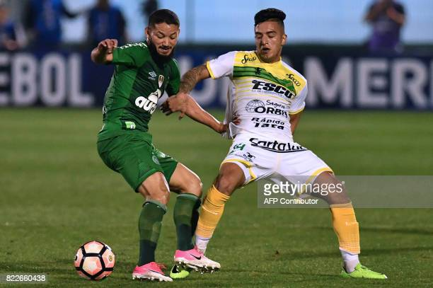 Rossi of Brazil's Chapecoense vies for the ball with Leonel Miranda of Argentina's Defensa y Justicia during their Copa Sudamericana football match...