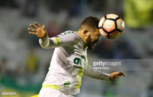 Rossi of Chapecoense heads the ball during a first leg match between Defensa y Justicia and Chapecoense as part of second round of Copa Conmebol...