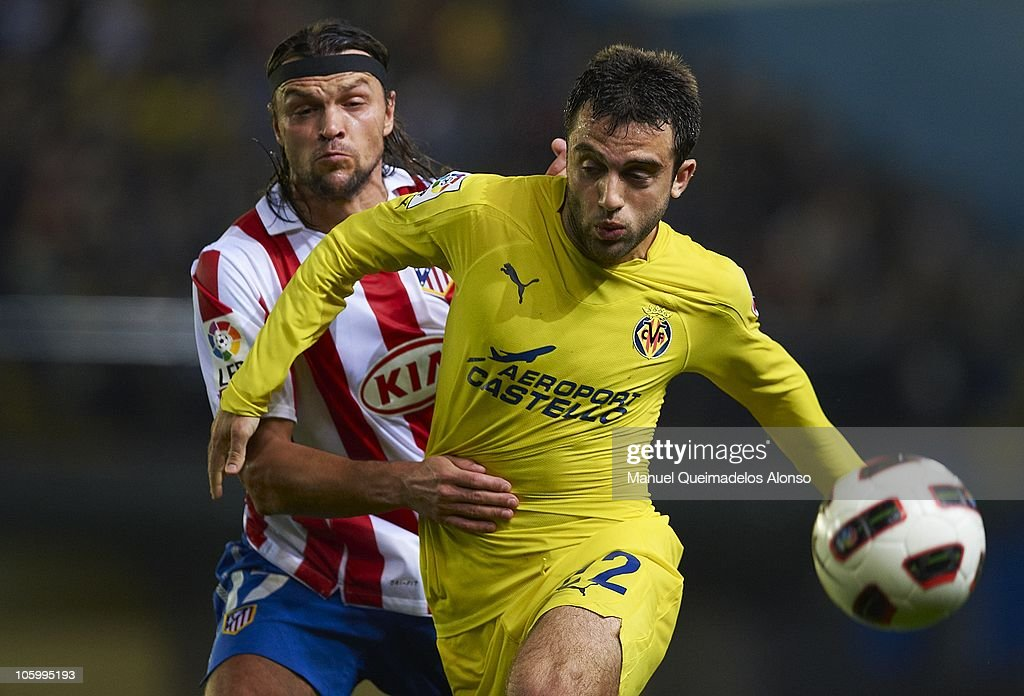 Rossi (R) of Villarreal duels for the ball with Ulfalusi of Atletico de Madrid during the La Liga match between Villarreal and Atletico de Madrid at El Madrigal on October 24, 2010 in Villarreal, Spain.