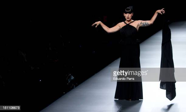 Rossy de Palma walk the runway in the Juanjo Oliva fashion show during the Cibeles Madrid Fashion Week Spring/Summer 2013 at Ifema on September 1...