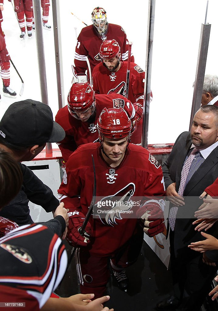 Rostislav Klesla #16 and Zbynek Michalek #4 of the Phoenix Coyotes are greeted by fans as he skate off the ice following the NHL game against the Colorado Avalanche at Jobing.com Arena on April 26, 2013 in Glendale, Arizona. The Avalanche defeated the Coyotes 5-4 in an overtime shoot-out.