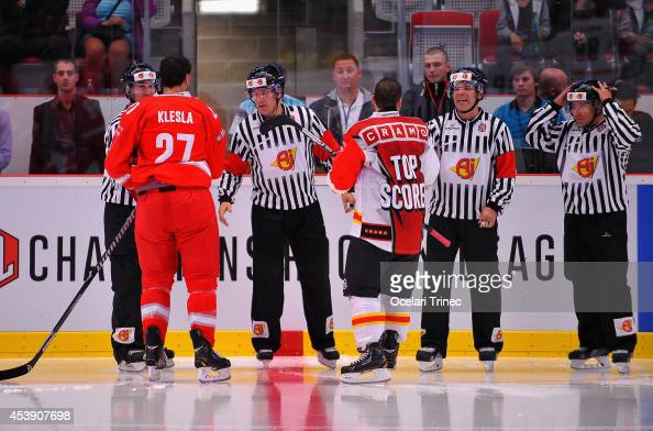 Rostislav Klesla of HC Ocelari Trinec and Martin Pluss of SC Bern have a heated discussion with the match officials during the Champions Hockey...