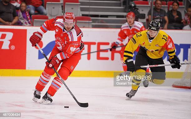Rostislav Klesla of Ocelari Trinec and Topi Piipponen of Kalpa Kuopio skates on ice during the Champions Hockey League group stage game between...