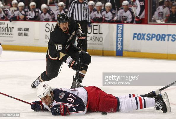 Rostislav Klesla of the Columbus Blue Jackets hits the ice defending the puck against George Parros of the Anaheim Ducks during the game on November...