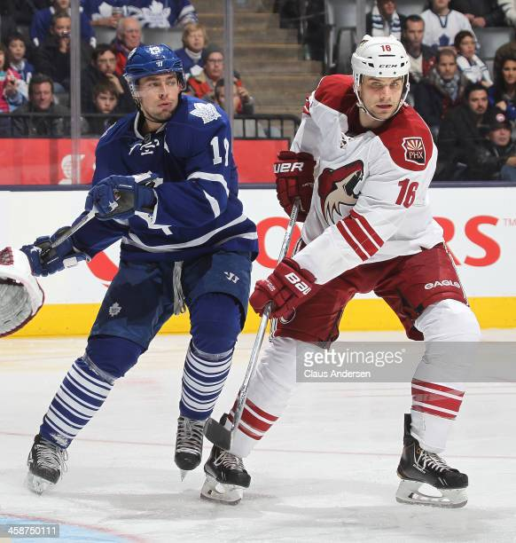Rostislav Klesla of the Phoenix Coyotes keeps a check on Joffrey Lupul of the Toronto Maple Leafs during an NHL game at the Air Canada Centre on...
