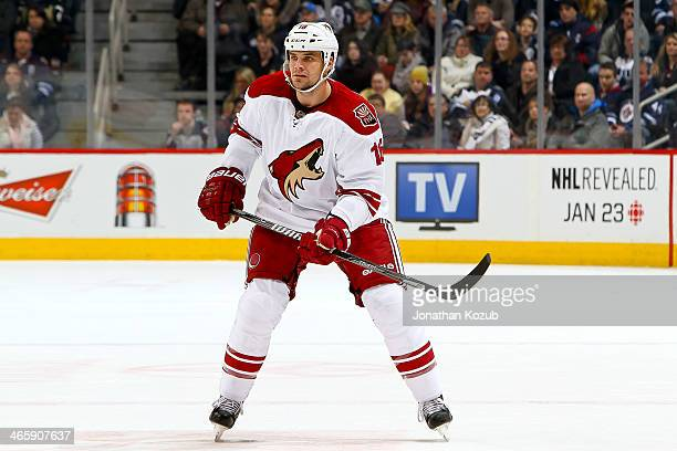 Rostislav Klesla of the Phoenix Coyotes keeps an eye on the play during first period action against the Winnipeg Jets at the MTS Centre on January 13...