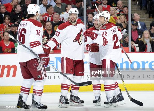 Rostislav Klesla of the Phoenix Coyotes skates over to celebrate with teammates Adrian Aucoin Ray Whitney and Daymond Langkow after the Coyotes...