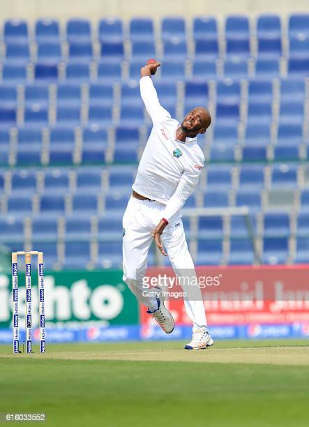 Roston Chase bowls during Day One of the Second Test between Pakistan and the West Indies at the Zayed Cricket Stadium on October 21 2016 in Abu...