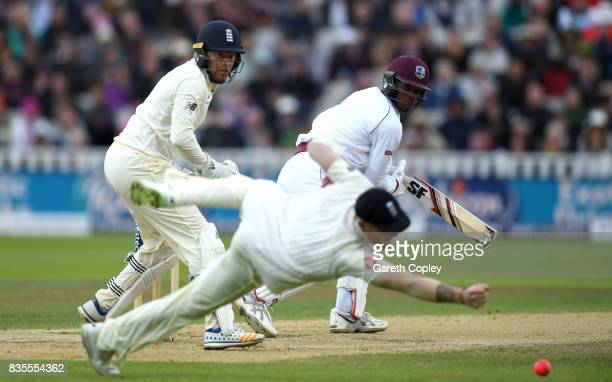 Roston Chase of the West Indies hits past Ben Stokes of England during day three of the 1st Investec Test between England and the West Indies at...