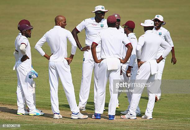 Roston Chase of West Indies celebrate with teammates after dismissing Yunus Khan of Pakistan during Day One of the Third Test between Pakistan and...