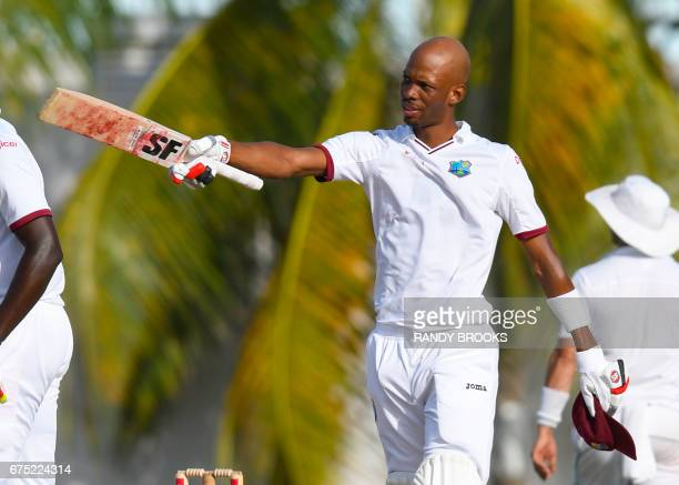Roston Chase of West Indies celebrates his century during the 1st day of the 2nd Test match between West Indies and Pakistan at Kensington Oval...