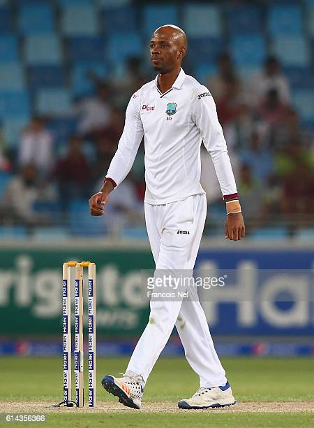 Roston Chase of West Indies looks on during Day One of the First Test between Pakistan and West Indies at Dubai International Cricket Ground on...