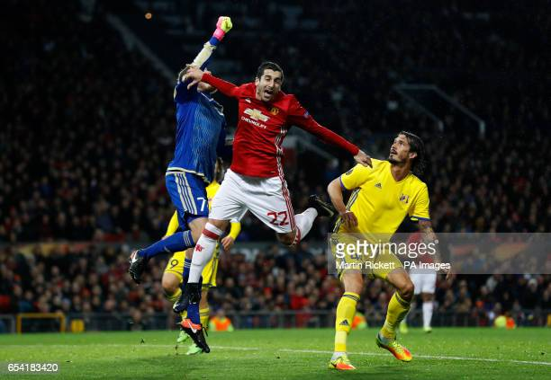 FC Rostov's Nikita Medvedev and Manchester United's Henrikh Mkhitaryan contest a ball in the air during the UEFA Europa League Round of Sixteen...
