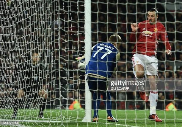 Rostov's Russian goalkeeper Nikita Medvedev saves an early chance for Manchester United's Swedish striker Zlatan Ibrahimovic during the UEFA Europa...