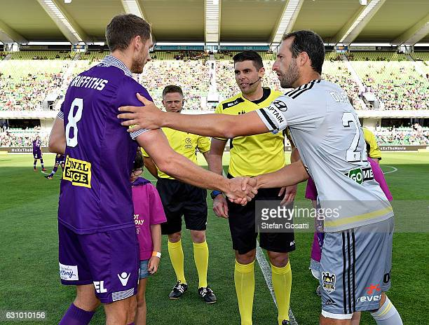 Rostyn Griffiths of the Glory and Andrew Durante of the Phoenix shake hands after the toos before the round 14 ALeague match between the Perth Glory...