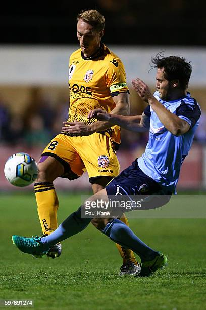 Rostyn Griffiths of the Glory and Josh Brilante of Sydney contest for the ball during the round 16 FFA Cup match between Perth Glory and Sydney FC at...
