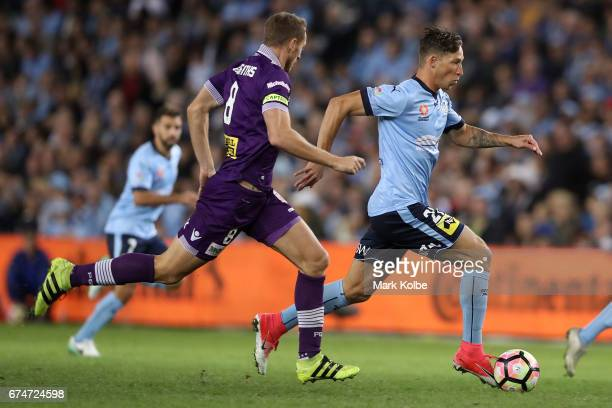 Rostyn Griffiths of the Glory chases Filip Holosko of Sydney FC as he runs the ball forward during the ALeague Semi Final match between Sydney FC and...