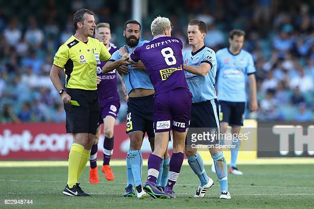 Rostyn Griffiths of the Glory has a disagreement with Brandon ONeill of Sydney FC and Sydney FC captain Alex Brosque during the round six ALeague...