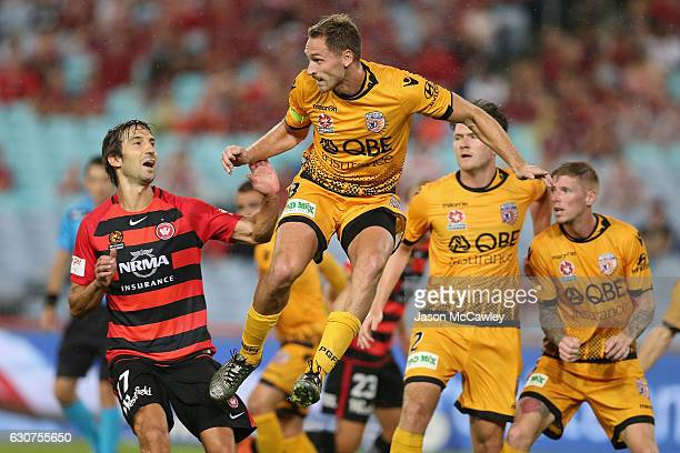 Rostyn Griffiths of the Glory heads the ball during the round 13 ALeague match between the Western Sydney Wanderers and Perth Glory at ANZ Stadium on...