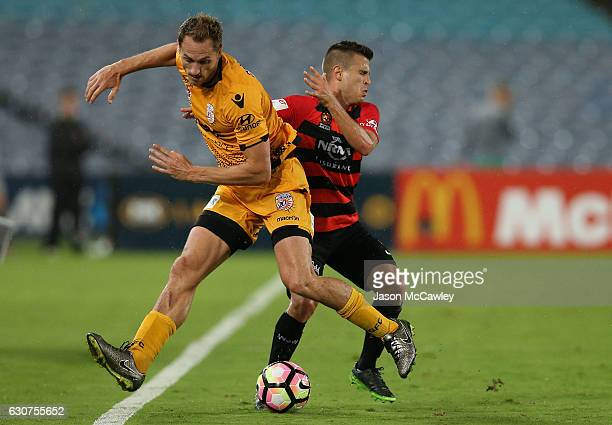 Rostyn Griffiths of the Glory is challenged by Nicolas Martinez of the Wanderers during the round 13 ALeague match between the Western Sydney...
