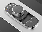 Rotary knob style gear selector on the central console in a luxury car